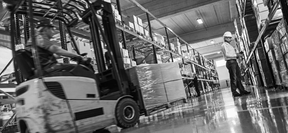 Forklift moving pallets in a warehouse