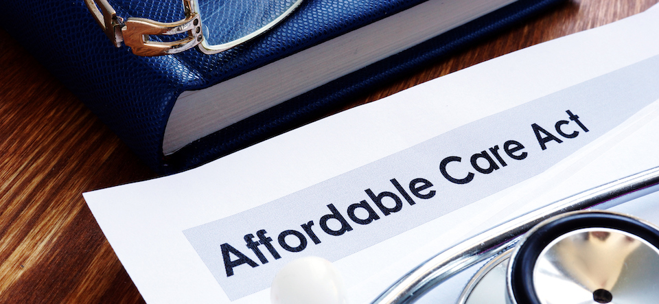 Document with Affordable Care Act written on the top