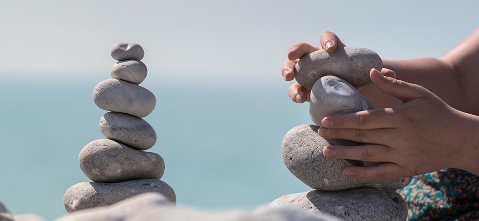Hands balancing stones