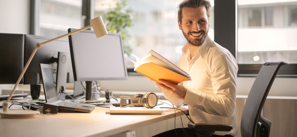Happy man working at his home desk