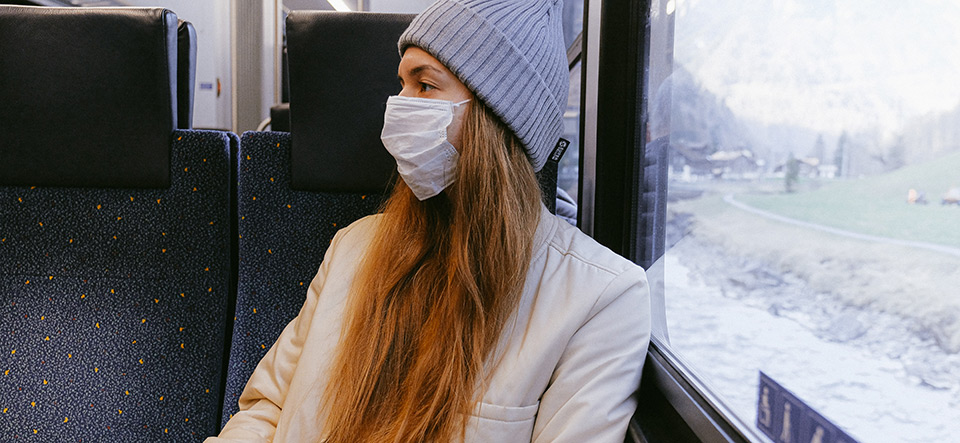 Woman wearing a mask on public transportation