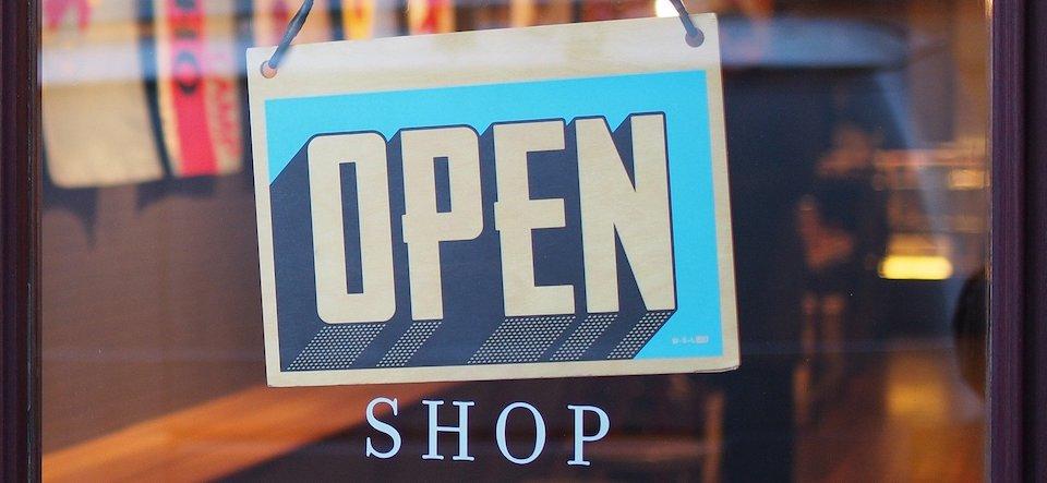 Open sign in a shop door window