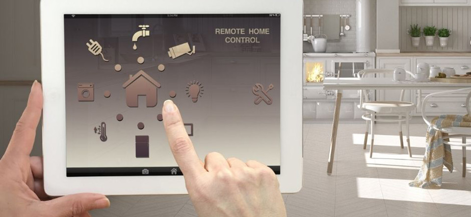 Hand using a tablet device to control smart home appliances