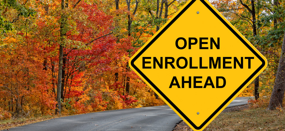 Open Enrollment Caution Sign With Autumn Road Background
