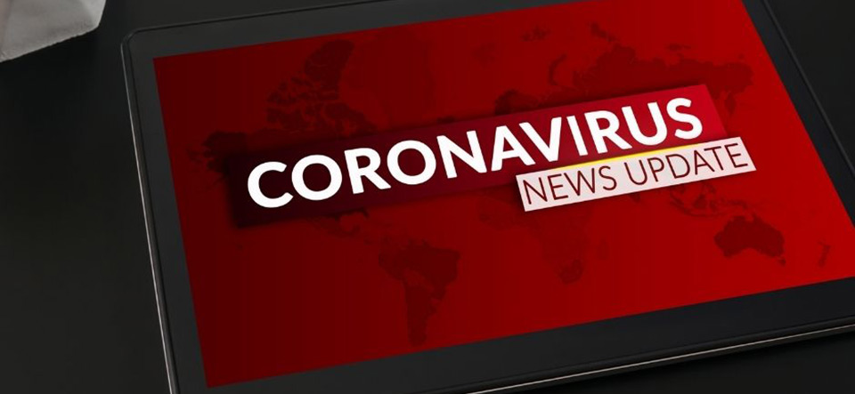 Tablet computer with a coronavirus news update on screen
