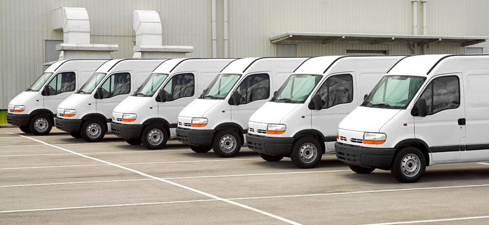 A row of service vehicles parked in a lot