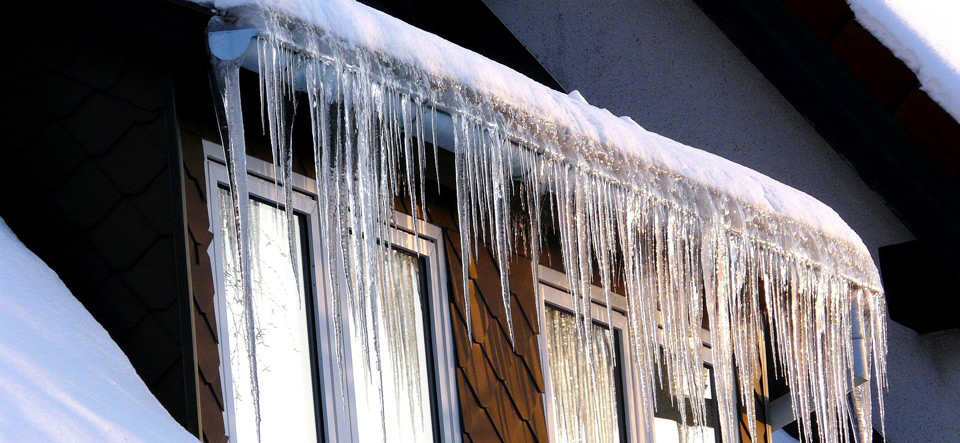 Icecicles hanging from roof overhang