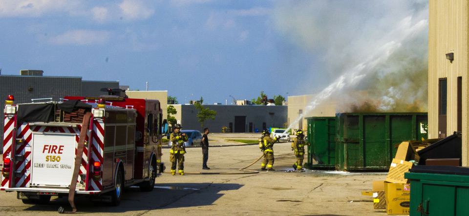 Fire fighters spraying a building