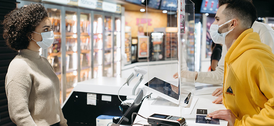 Customer safely shopping and paying for an item during pandemic