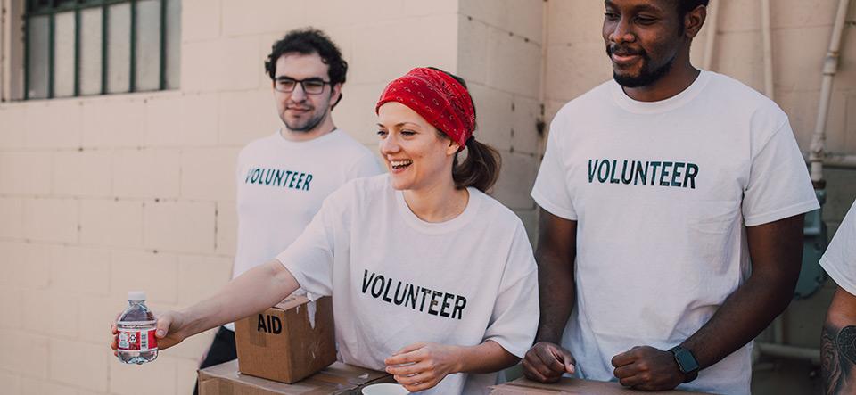 Volunteer workers handing out goods