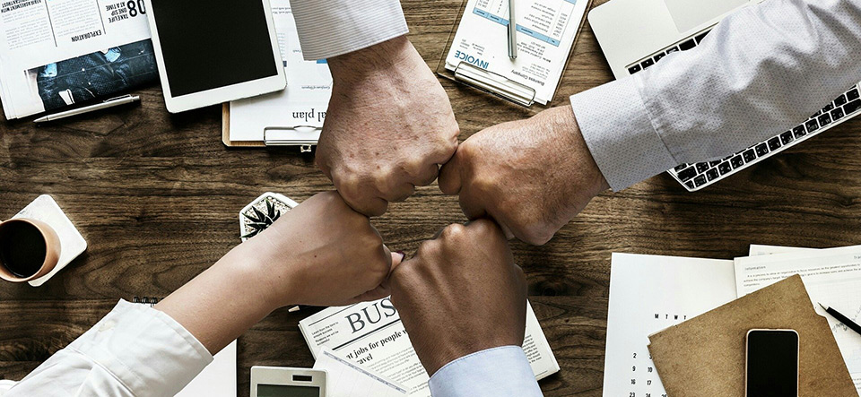 Group of hands coming together for team encouragement
