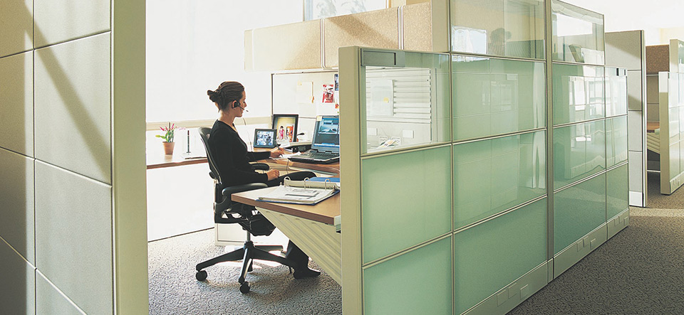 Woman working in an office cubicle