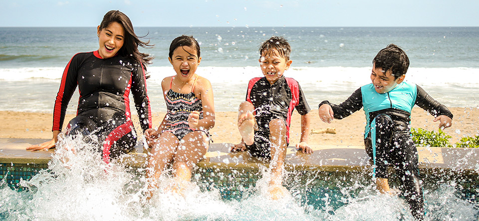 Family playing in the water on a sunny day